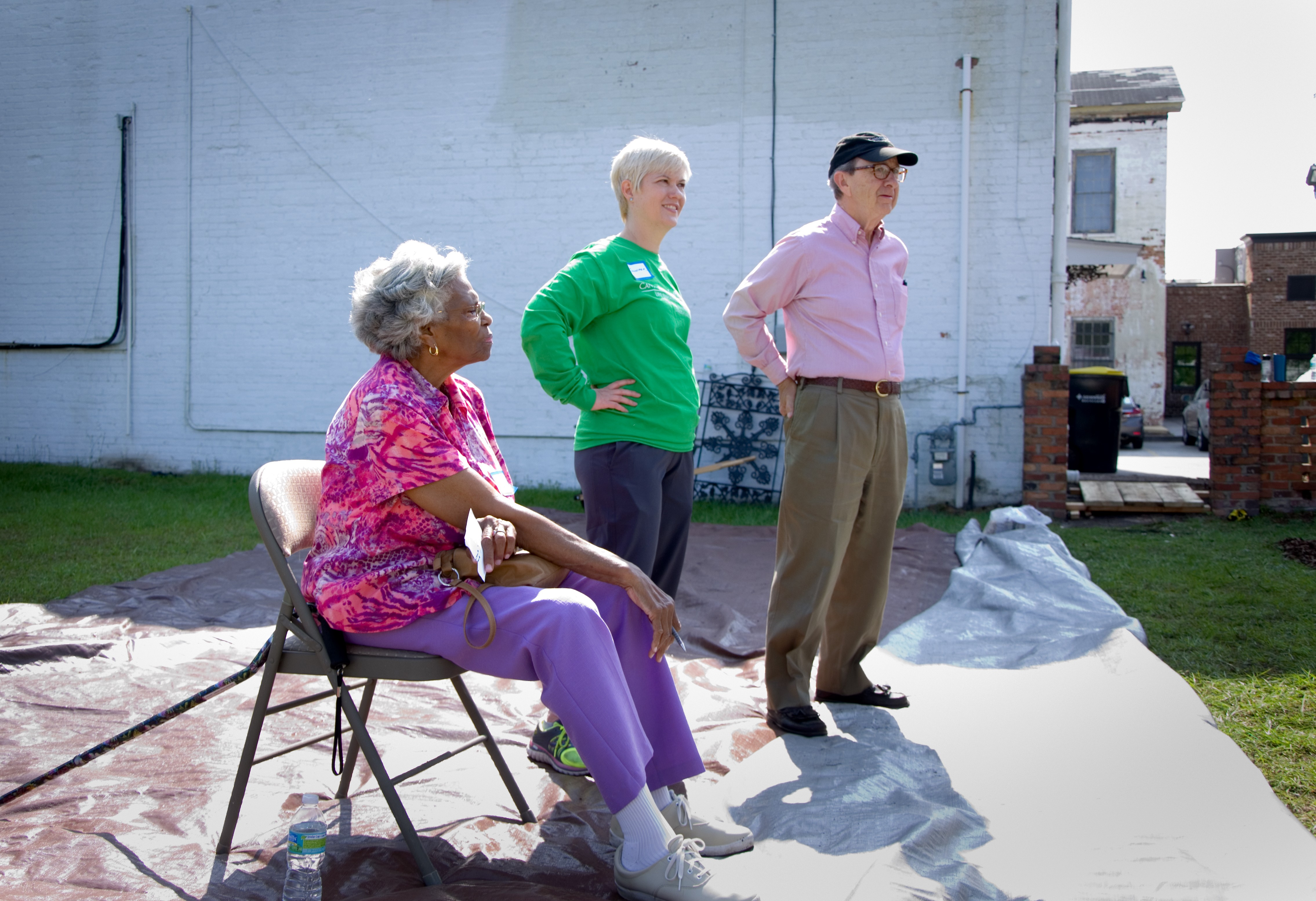 CRI Healthy Garden volunteer Catherine Torrence from Second African Baptist Church, CRI Executive Director Jennifer Cabe, and Charles H. Morris view the garden installation at Trustees' Garden, which is owned by Charles. Charles and his wife Rosalie are the funding partners for the CRI Healthy Garden.