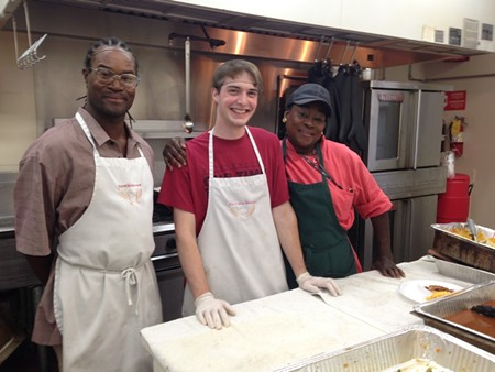Emmaus House chef Freda Payne (right) oversees the soup kitchen's volunteers and food donations