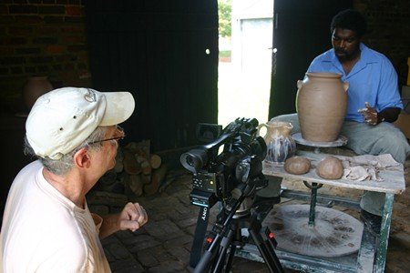Filmmaker Mark Albertin directs actor Darion McCloud, who portrays the enslaved potter in the documentary Discovering Dave. Photo by George Wingard