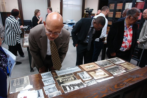 Former Mayor Otis Johnson peruses some of the W.W. Law collection