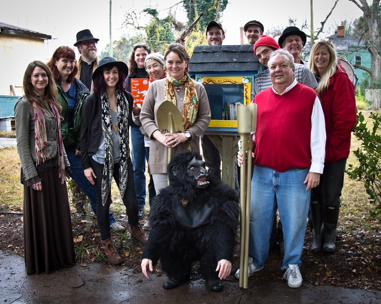 Friends of newlyweds Francis Allen and Leslie Lovell (r. and l. of the gorilla) helped dedicate the first FOC Little Free Library. - JON WAITS/@JWAITSPHOTO
