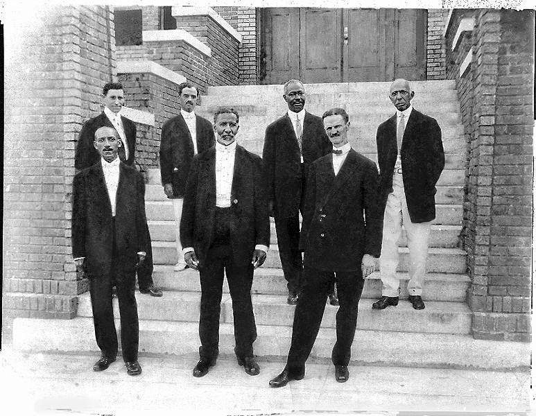 front row, l. to r.) Carnegie Library founders E.E. DesVerney, Burton H. Pearson and A.L. Tucker stand with (back row, l. to r.) Duncan Scott, Dr. F.S. Belcher, Sol C. Johnson and C.A. McDowell, who served as the institution's first librarian.
