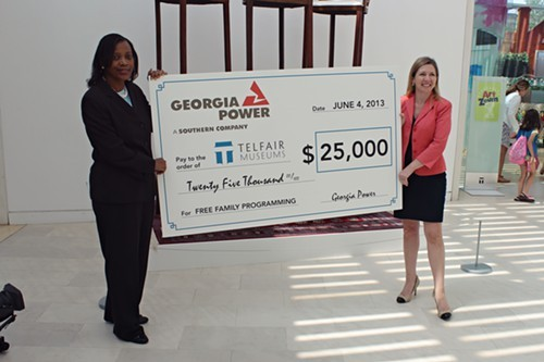 Georgia Power vice president Cathy Hill (left) recently presented Telfair Museums director/CEO Lisa Grove (right) with a $25,000 check to support free Family Day programming at the Jepson Center.