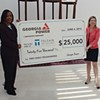 GA Power gives Telfair HUGE check, literally