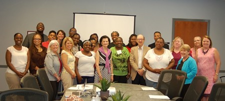 Graduates of the first CRI Life Enhancement Program at Curtis V. Cooper Primary Health Care are pictured here with civic leaders Rosalie Morris (center, with pink sweater) and Charles H. Morris (front in tan jacket) and the members of the integrative health Core Team that guided participants through the 12 weeks that focused on the importance of the health of the total person – mind, body, spirit, and emotion.