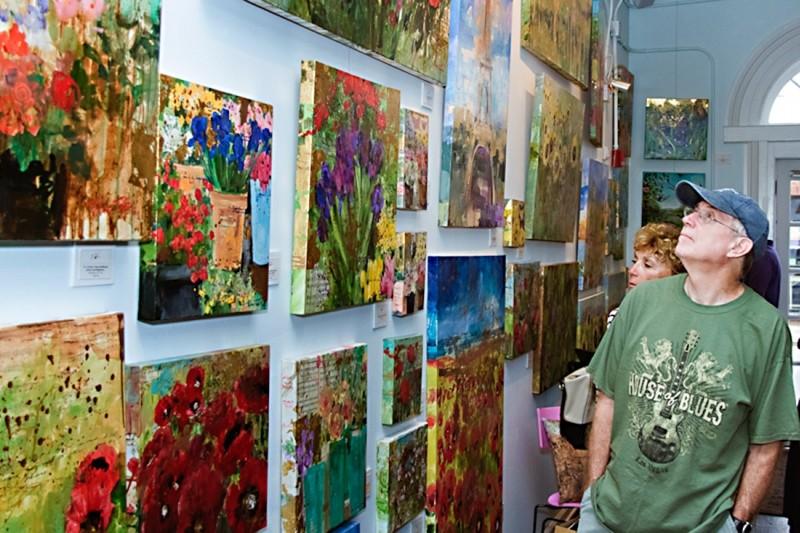 Guests on Savannah Art Walk explore Tiffani Taylor's gallery space on Whitaker Street - NUNO SERRANO