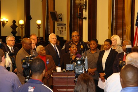 In better days, former Chief Willie Lovett stands directly behind Mayor Edna Jackson with other members of City  Council