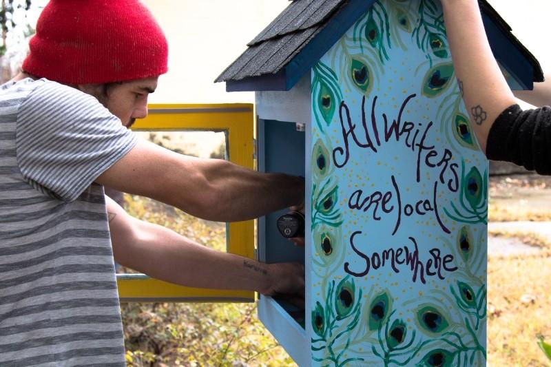 Jeremiah Jossim (above l.) installed the first book box - JON WAITS/@JWAITSPHOTO