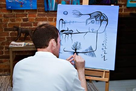 Jonathan G Keller in his City Market gallery and studio space during Savannah Art Walk. - NUNO SERRANO