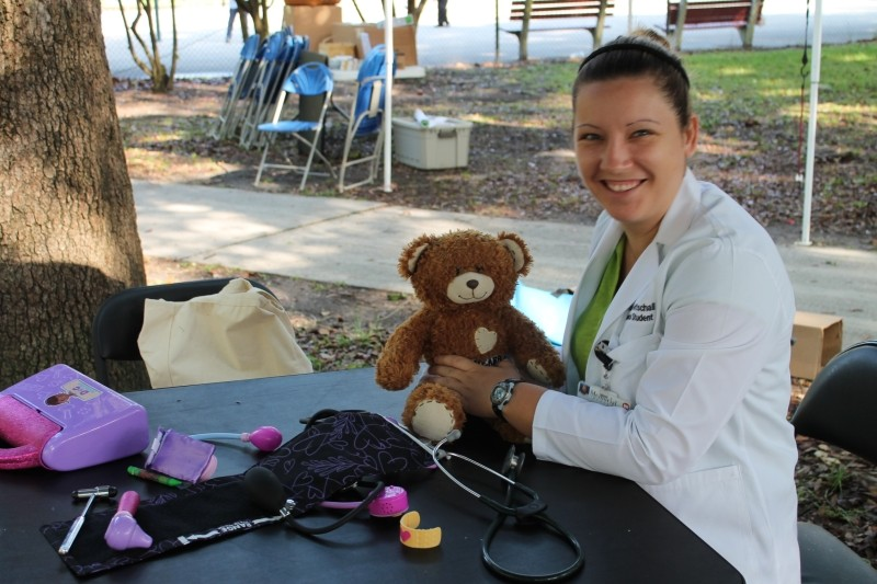 Mercer medical students diagnose stuffed animal ailments at the Forsyth Farmers Market while their human counterparts receive free health screenings.