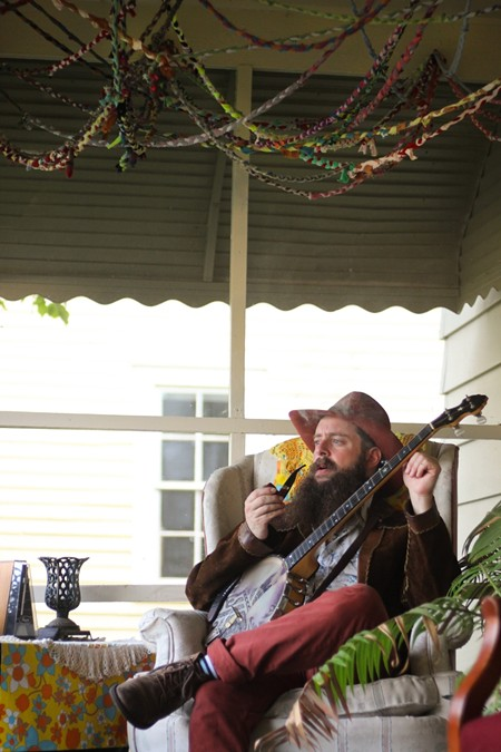 Mike Savino of Tall Tall Trees cozies up with his custom banjotron (it lights up!).