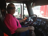 Port truckers like Carol Cauley work 16 hours a day with no overtime.