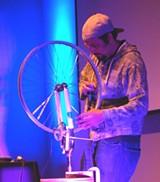 adam_matta_scratching_with_bike_wheel_2011.jpg