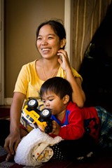 JON WAITS - Refugee Muani Sang escaped the war and violence of Burma/Myanmar with her husband, four children and mother-in-law and brother-in-law. Relocated to Savannah by Lutheran Services of Georgia, the family is adjusting to Christmas in a new land.