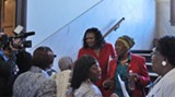 Rochelle Small-Toney is congratulated by community members after the meeting