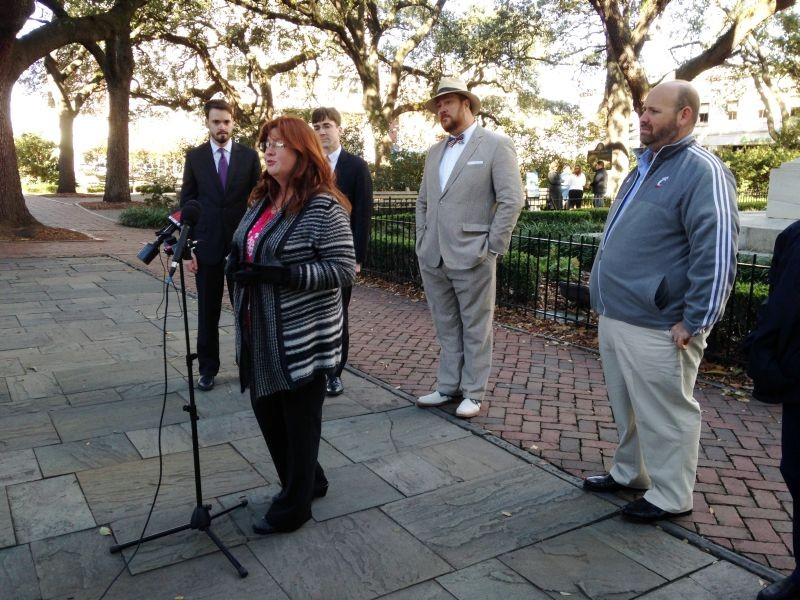 Savannah Belles Walking Tours owner Michelle Freenor (center) addresses the media with her husband, Steven (r.), 'Savannah Dan' Léger and their attorneys.
