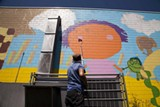 LENS ANDERSON - SeeSAW brings color and class to the wall at the West Broad YMCA.