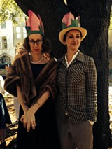 "Sing along now: ""I love a parade..."" Artist Katherine Sandoz (left) marched as Flannery O'Conner with nattily-dressed organizer Christine Sajecki."