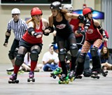 Slam! Pow! Another out-of-town jammer blocked by the mighty Derby Devils!