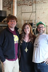 Southbound Brewing Co.'s Smith Mathews (l.) and Carly Wiggins (center) with PERC's Philip Brown