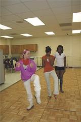 Sue Braddy, left, helps dancers prepare