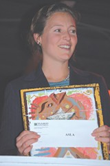 Tanya Mandel of the American Society of Landscape Architects Georgia Chapter with the Healthy Community Grant Award (an original painting by Eric Longo on recycled metal) and check