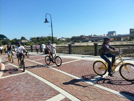 The Frank K. Martin Bridge spans the Chattahoochee River and links Columbus, Ga. to Phenix City, Ala. The bridge that formerly carried cars is now used by people who walk and bicycle. Photo courtesy Georgia Bikes