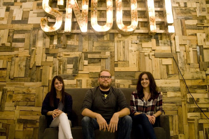 The Le Snoot team at their new location. L-R: Kori Gibson, client consultant, Logan McDonald, founder and creative director, and Sasha Loseva, accounting.