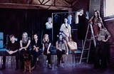 The Savannah Independent Designers pose at Dollhouse Studios, l. to r: Troy Allen, April Johnston, Meredith Sutton, Blake Mavrogeorgis, Nanci Zabko, Leslie Miller, Risha Carnes, model Nikki Lomelli and Emily Bargeron. Not pictured: Brooke Atwood. PHOTO: Pat Bombard