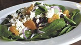 The spinach salad at Caraway Cafe