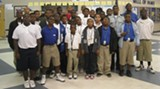 PROVIDED BY DERENNE MIDDLE SCHOOL - The young men of ASPIRE pose in the school Atrium
