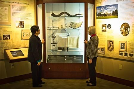 Toby Hollenberg (l.) and Eileen Lobel look at almost 300 years of Savannah Jewish history. - JON WAITS/@JWAITSPHOTO