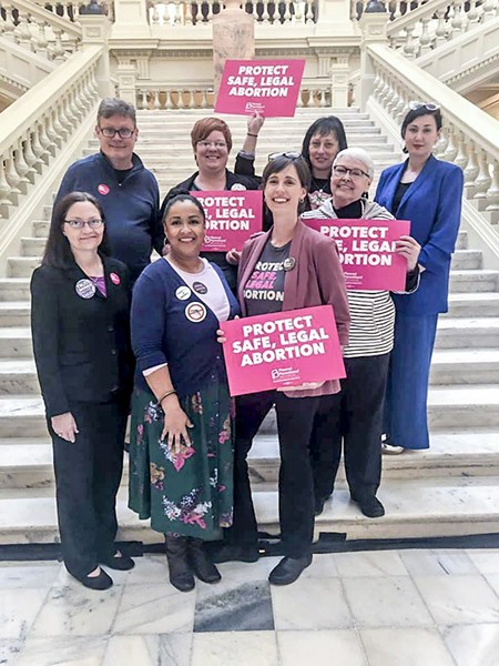 Part of a group from Savannah who traveled to Atlanta to make sure their voices were heard by the Chatham delegation. Front row: Yvette Upton, Leona Humphries, Kate Dunnagan, Joan Wade. Back row: Glen Hamilton, Kathryn Shelton, Jessica Leigh Lebos, Coco Papy.