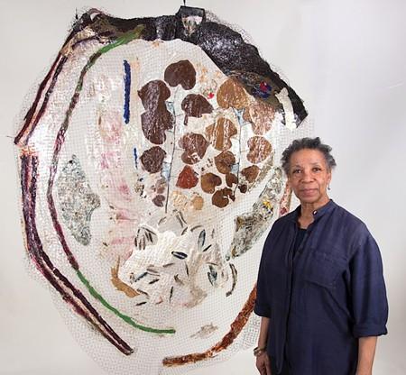 Suzanne Jackson with her work Woodpecker's Last Blues (2013).  Photo by David Kaminsky.