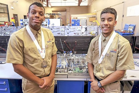 Savannah Tech's mechatronics team, with students Victor De La Cruz and Anthony Smith, won gold in the SkillsUSA competition.