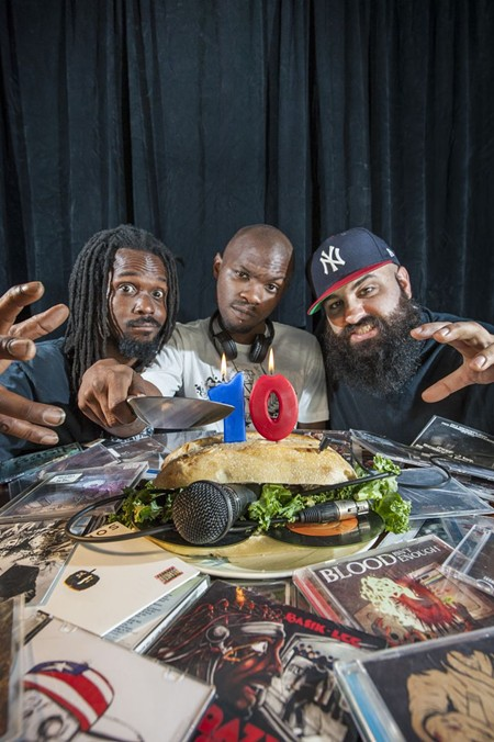 Surrounded by 10 years of CDs, Steve Baumgardner (Basik Lee), Kedrick Mack (Dope KNife), and Max Lipson (Miggs Son Daddy) blow out the candles. - GEOFF L. JOHNSON