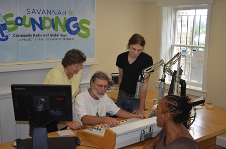 (L. to R.) Savannah Soundings project manager Vicki Weeks helps test the station's new soundboard with program hosts Kevin Ionno and Mitchell Miller as Unitarian Universalist Church President Denise German looks on.
