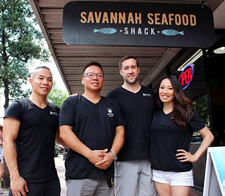 """Owners and partners, including husband and wife duo, Christine and David Cutlip, as well as her father Timmy Tsoi and brother Jonathan Tsoi (right to left) can be seen, on any given day, sculpting ice cream, waiting tables and delivering food to local businesses themselves. """"We want people to see our faces and know that we care"""""""