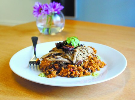 A taste of Puerto Rico with Nana's Arroz con Pollo - (chicken with rice), made with sazon roasted chicken thighs.