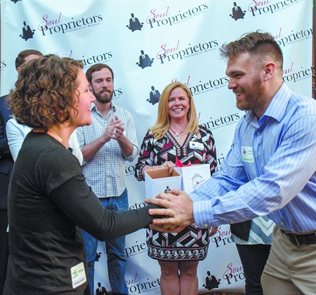 Green Truck Pub's Whitney Yates (l.) meets Zachary Burke of Ardsley Park Productions as Soul Proprietors founder Debbie Brannigan looks on.