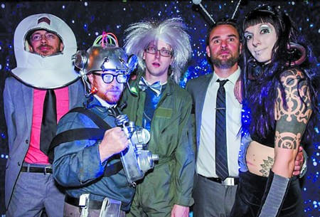 The Wave Slaves strike a pose in the 3rd Annual Rock & Roll Prom photo booth. - PHOTO BY PETERSON WORRELL