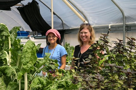 Dr. Heather Joesting (R) oversees experiments with the help of student Sakile Johnson at the FORM Sustainable Aquaponics Research Center. - PHOTOS BY JON WAITS /@JWAITSPHOTO