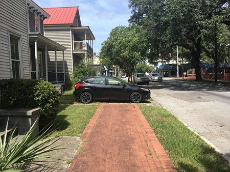 People who walk in Savannah frequently face barriers, like this car parked on the Anderson Street sidewalk. When Bird e-scooters arrive in Savannah will they add to the problems or provide a needed mobility option?