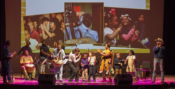 Yacouba Sissoko, Laiken Love, Anders Thomsen and company bring schoolchildren onstage at the Trustees Theatre - PHOTO BY JOHN ALEXANDER