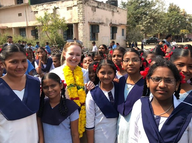 Cari Clark Phelps, third from left, and a group of Indian schoolchildren. The girl who spoke up about the bathrooms is to Phelps' right.