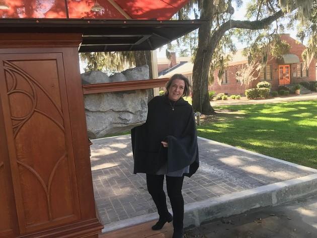 Sandra Champion with the Savannah Blarney Stone at its permanent home at Cohen's Retreat.