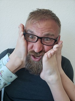 Tommy Nickoloff, with unidentified feet.