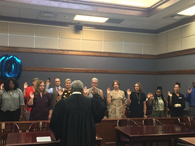 As soon as CASA volunteers are sworn in, they are ready to take their first case. Photo courtesy of CASA.