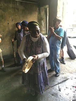 "Sistah Patt and the Saltwata Players sing a Gullah freedom song during an Underground Tour, in one of the ""Cluskey Vaults."" - PHOTO BY JIM MOREKIS"