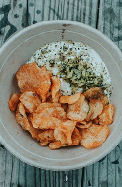 Labneh, dukkah, green olives, and Zapps chips.